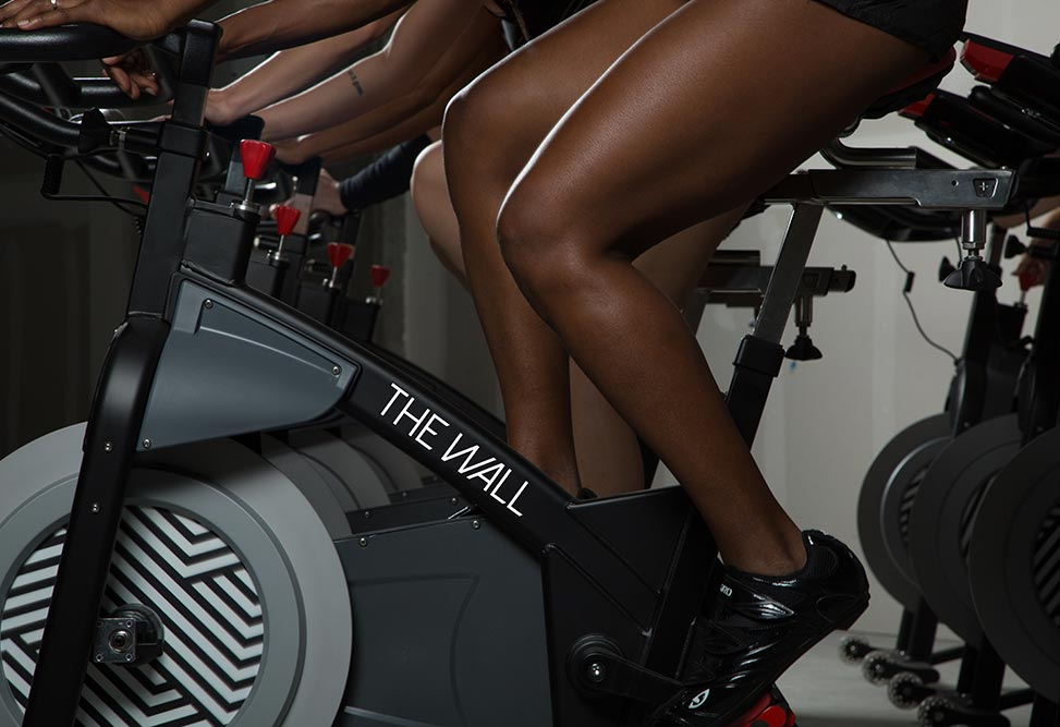 Indoor cycling at THE WALL: Increasing your metabolic rate allows your body to perform optimally. The interval training provided by indoor cycling does just that.